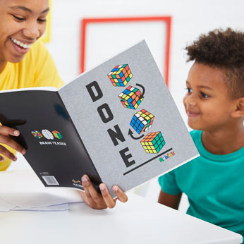 boy and girl in classroom with rubik's exercise book