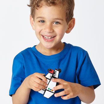 Young boy holding Rubik's Junior Bear