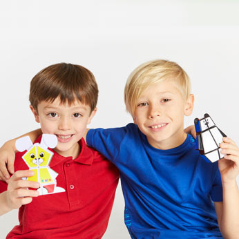 Two boys holding Rubik's Junior bear and bunny