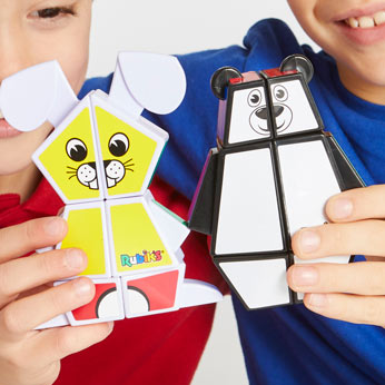 Two boys holding the Rubik's Junior bear and bunny
