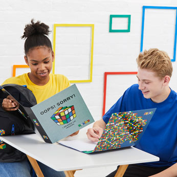Rubik's folders in classroom with boy and girl
