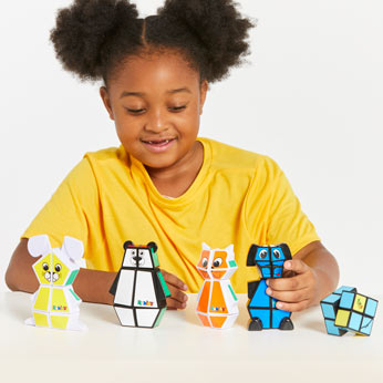 Young girl holding Rubik's Junior Collection
