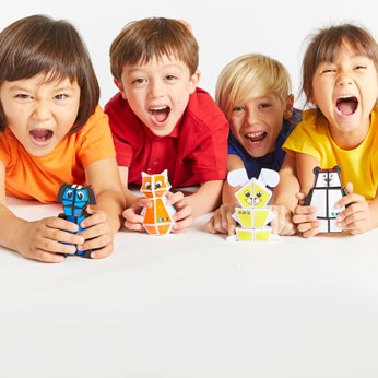 Children holding the Rubik's Junior Range