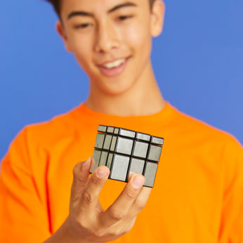 Rubik's solved mirror block in boys hands