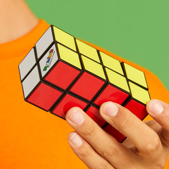 solved rubik's tower in boy's hands