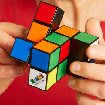 Jumbled Rubik's Tower in woman's hands