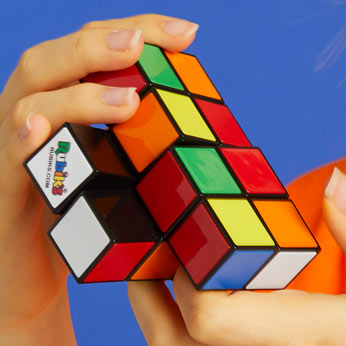 jumbled rubik's tower in boy's hands