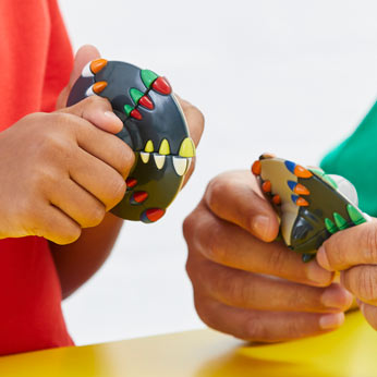 Father and son solving rubik's Ufo